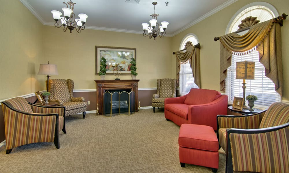 Lounge with fireside seating at Greenbrier Meadows in Martin, Tennessee