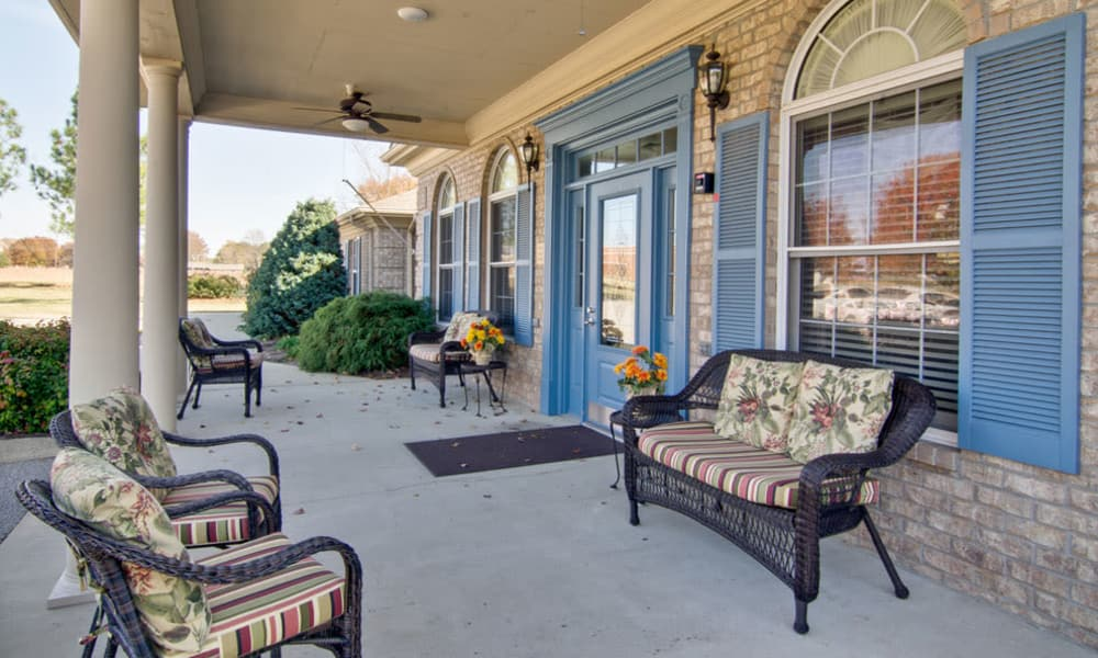 Front porch with covered seating at Greenbrier Meadows in Martin, Tennessee