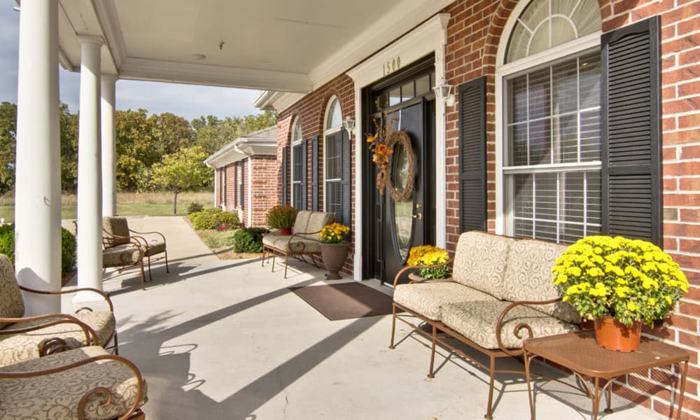 Front porch with covered seating at NorthRidge Place in Lebanon, Missouri