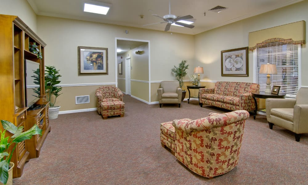 Entertainment room with comfortable seating at NorthRidge Place in Lebanon, Missouri