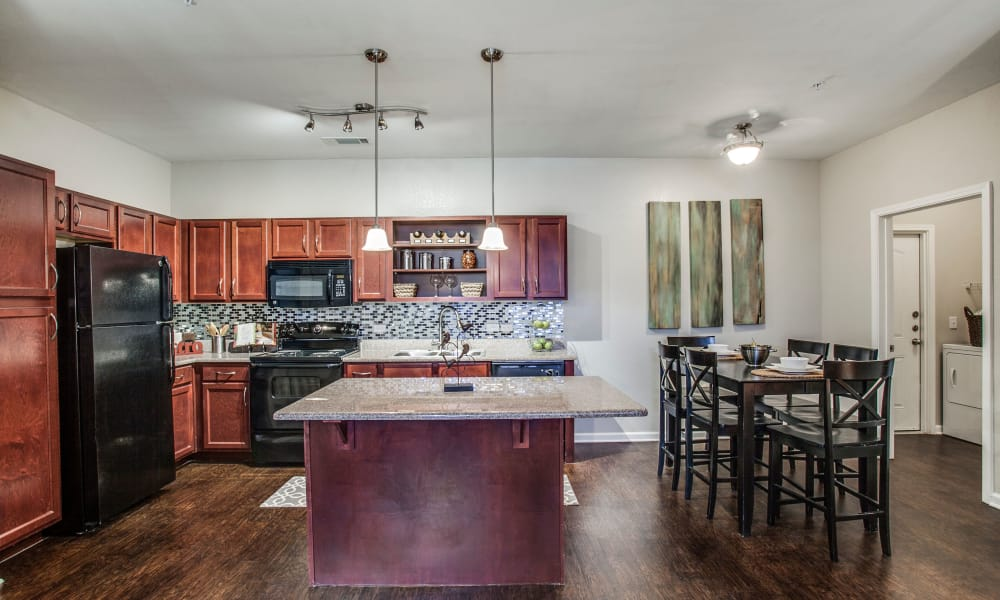 Our modern apartments at Overlook at Stone Oak Park in San Antonio, Texas showcase a kitchen