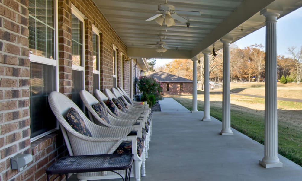 Back porch with covered seating at Eiffel Gardens in Paris, Tennessee