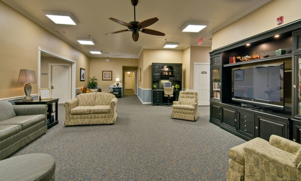 Entertainment room with comfortable seating at Southern Oaks in Henderson, Tennessee