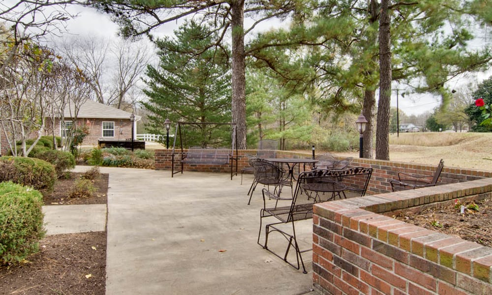 Concrete patio with seating at Southern Oaks in Henderson, TN