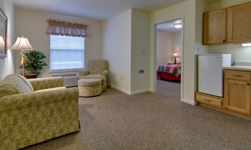 Apartment living room and kitchen at Southern Oaks in Henderson, Tennessee