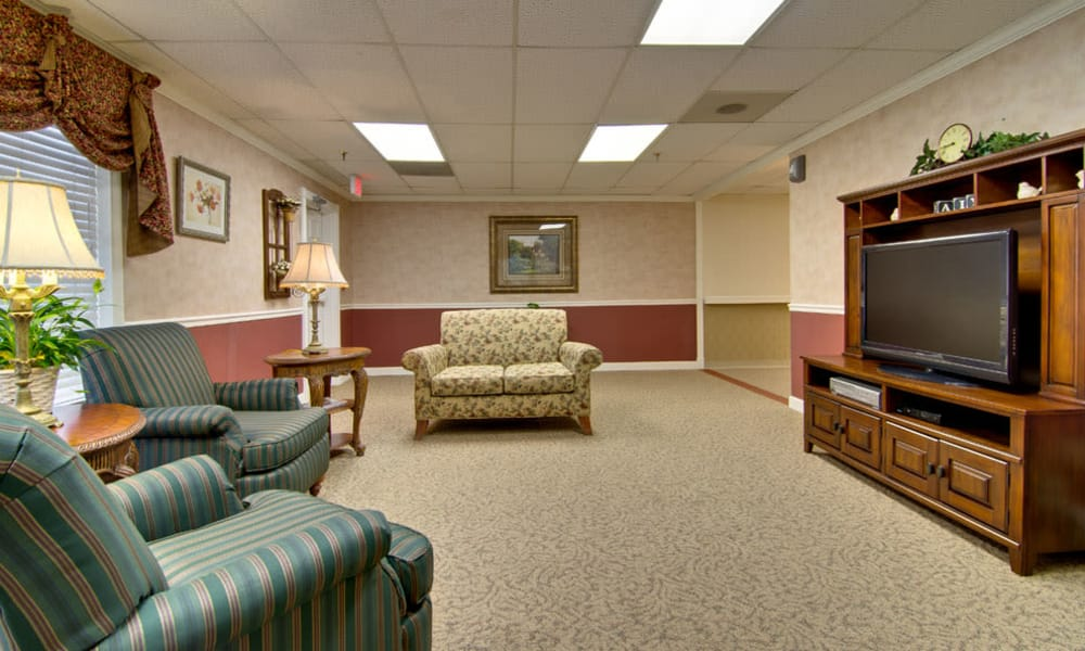 Entertainment room with comfortable seating at Spencer Place in Saint Peters, Missouri