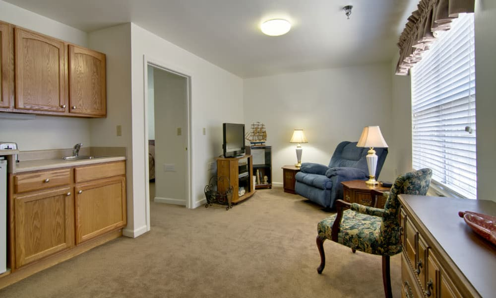 Assisted living kitchen and living room at Spring Ridge in Springfield, Missouri