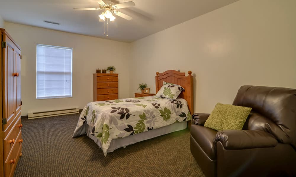 Assisted living bedroom at Ashbrook in Farmington, Missouri
