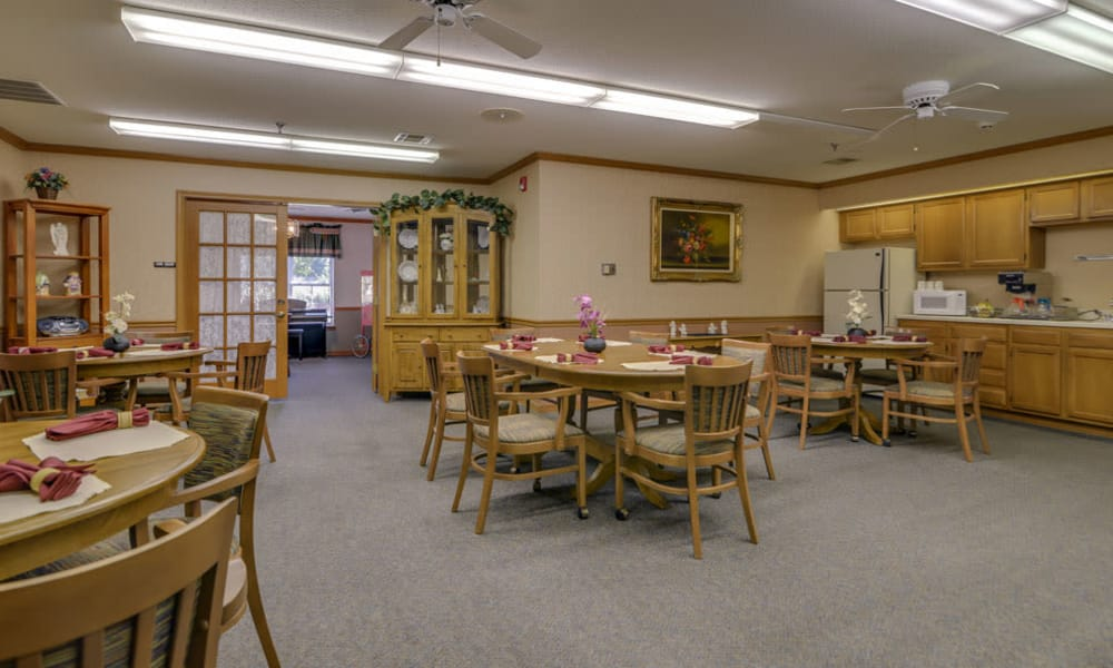 Dining room and community kitchen at Oswego Home Place in Oswego, Kansas
