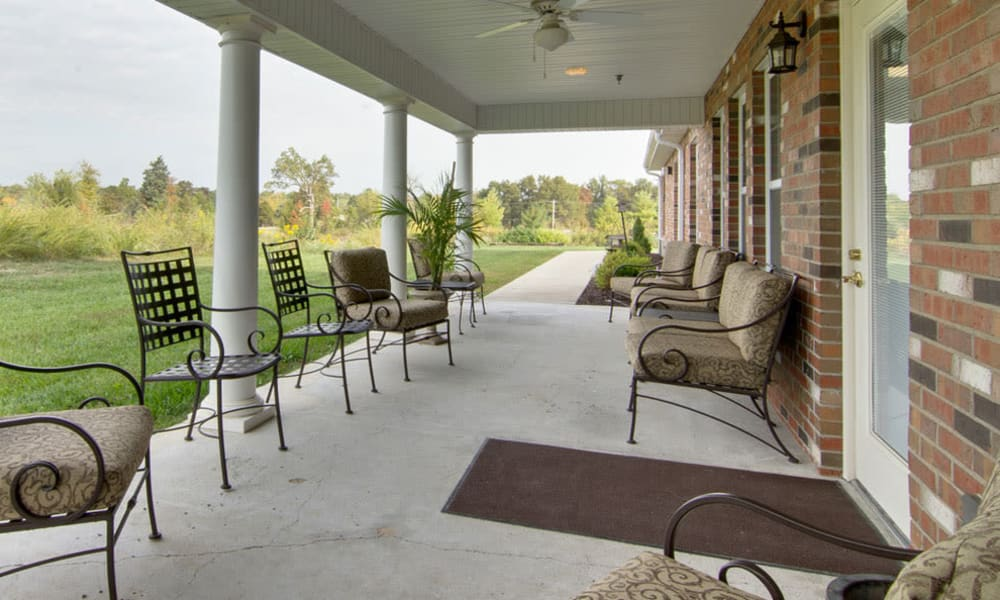 Covered seating on the back porch at Dunsford Court in Sullivan, Missouri
