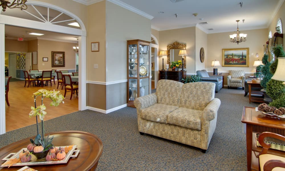 Resident lounge next to the dining room at Dunsford Court in Sullivan, Missouri