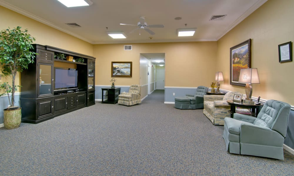 Entertainment room with comfortable seating at Dunsford Court in Sullivan, Missouri
