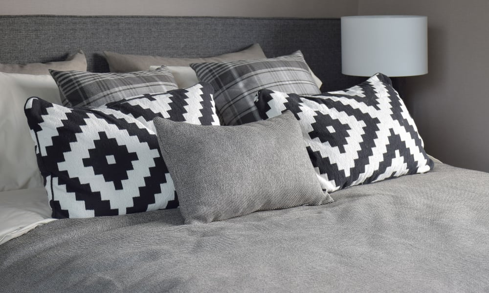 Decorative pillows in the master bedroom at Mount Vernon Garden Apartments in Alexandria, Virginia