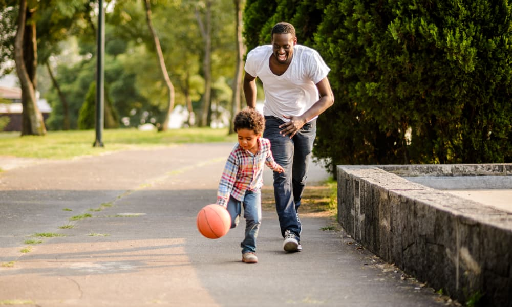 Father and son playing together in Springfield, Virginia at Westminster Oaks Townhomes