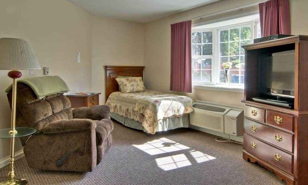 Bedroom and living room for assisted living residents at Ashland Villa in Ashland, Missouri