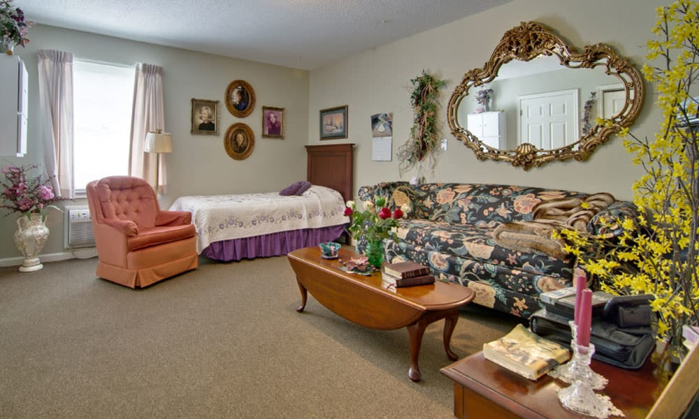 Apartment bedroom and living room at Willow Brooke in Union, Missouri