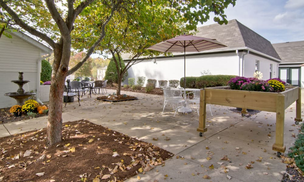 Outdoor seating and a planter box at Willow Brooke in Union, Missouri
