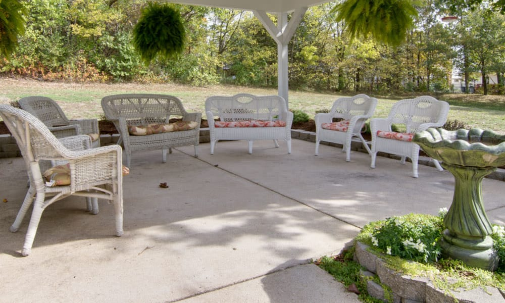 Outdoor patio with covered seating at Willow Brooke in Union, Missouri