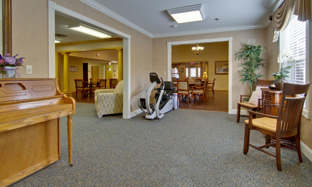 Music room with comfortable seating at Jefferson Gardens Senior Living in Clinton, Missouri