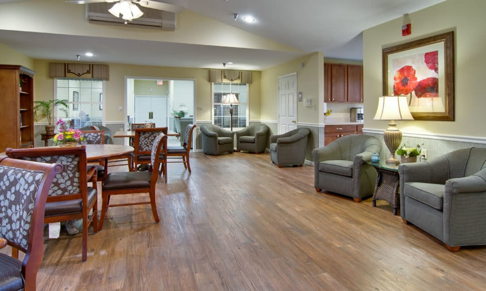 Community lounge seating in the dining room at Maple Tree Terrace in Carthage, Missouri