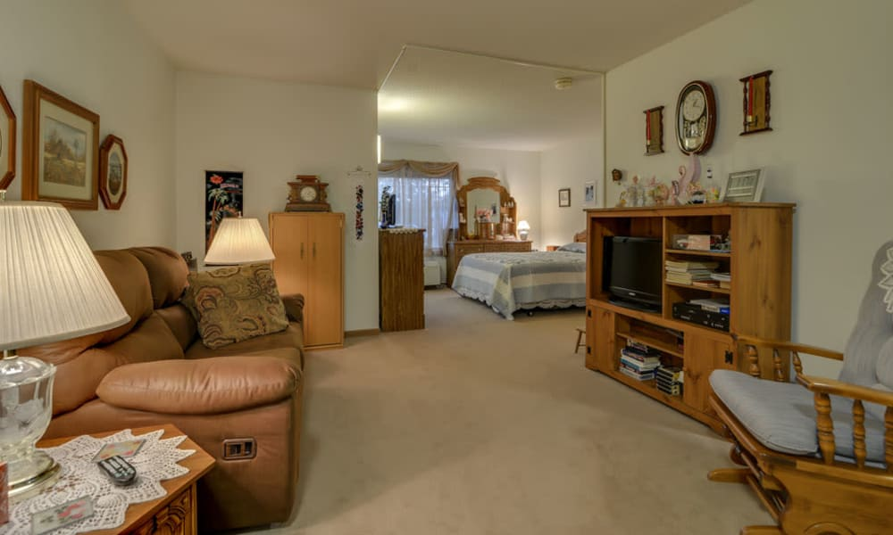 Apartment living room leading to the bedroom at River Bend in Great Bend, Kansas