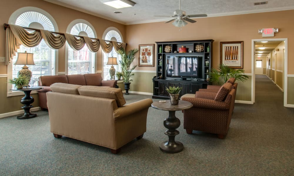 Entertainment room with comfortable seating at RiverWick in Savannah, Tennessee