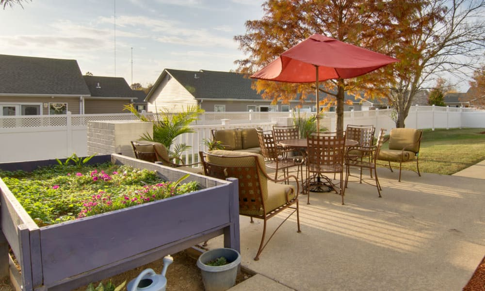 Outdoor patio with seating and a planter box at River Mist in Poplar Bluff, Missouri