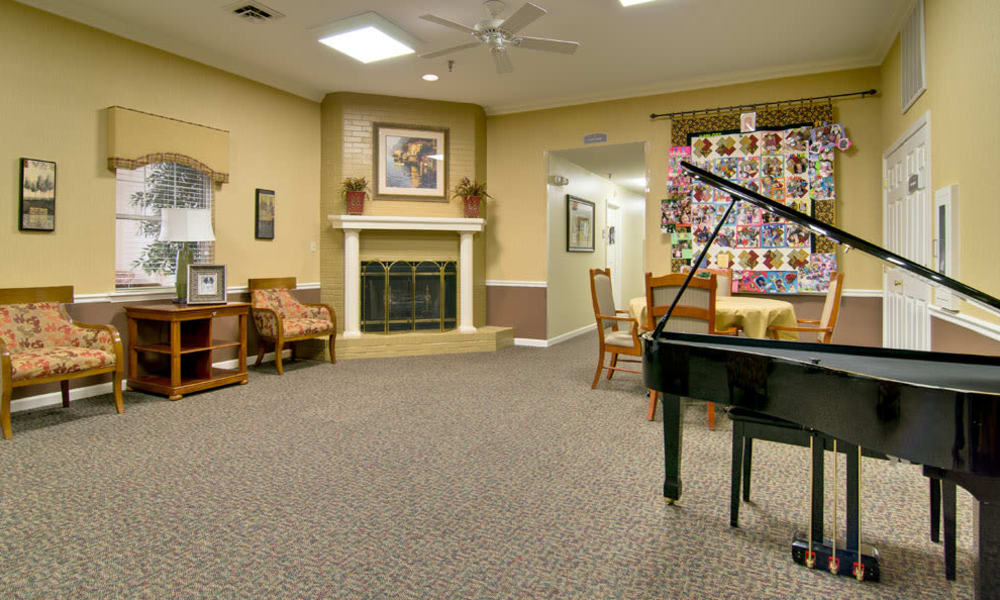 Music room with fireside seating at River Mist in Poplar Bluff, Missouri