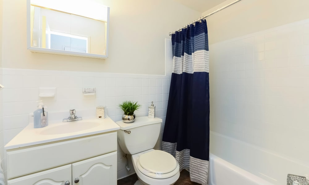 Cozy bathroom at Post & Coach Apartment Homes in Freehold, New Jersey