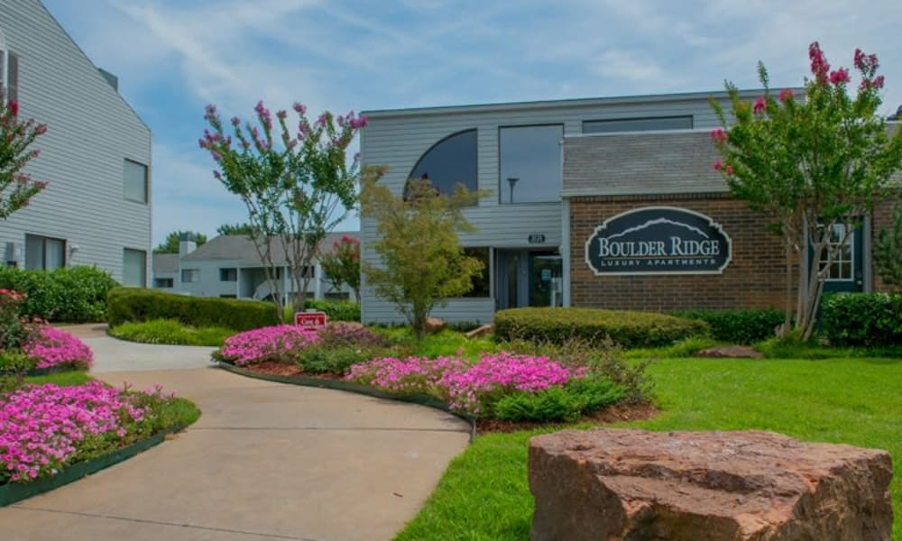 A beautifully landscaped area in front of the leasing office at Boulder Ridge in Tulsa, OK