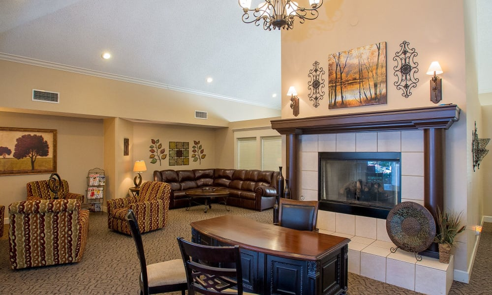 Clubhouse with a fireplace at Eagle Point Apartments in Tulsa, Oklahoma