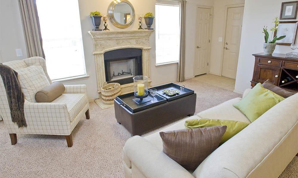 An apartment living room at Villas at Stonebridge in Edmond, Oklahoma
