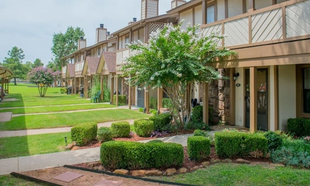A beautifully landscaped yard in front of the apartments at Barrington Apartments in Tulsa, OK
