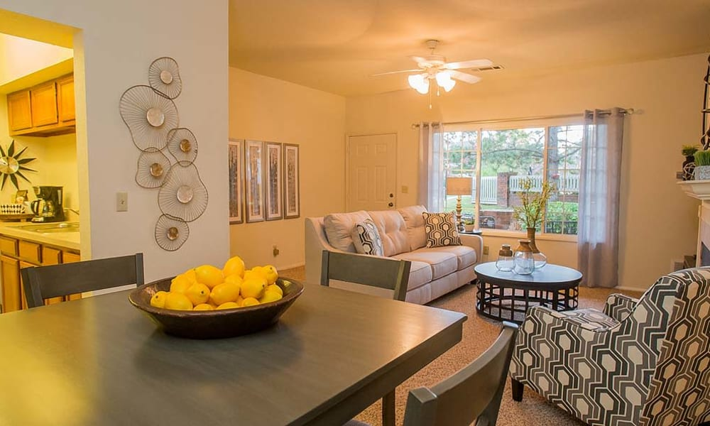 An apartment dining room and living room at The Courtyards in Tulsa, OK