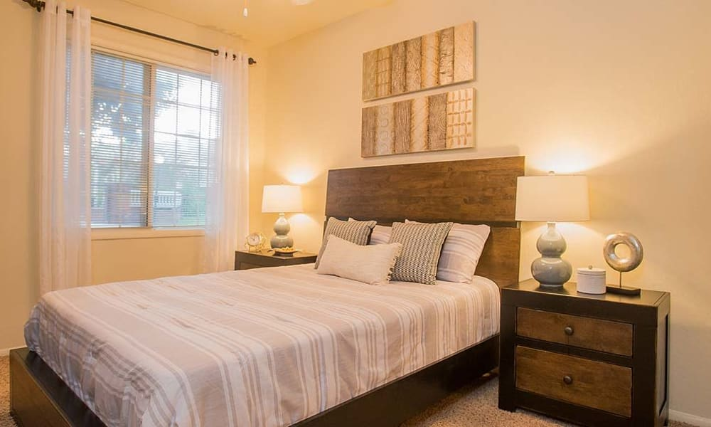 An apartment bedroom at The Courtyards in Tulsa, OK