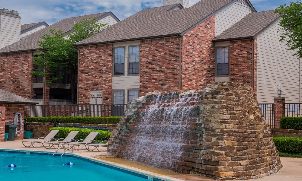 A waterfall by the pool at The Warrington Apartments in Oklahoma City, OK