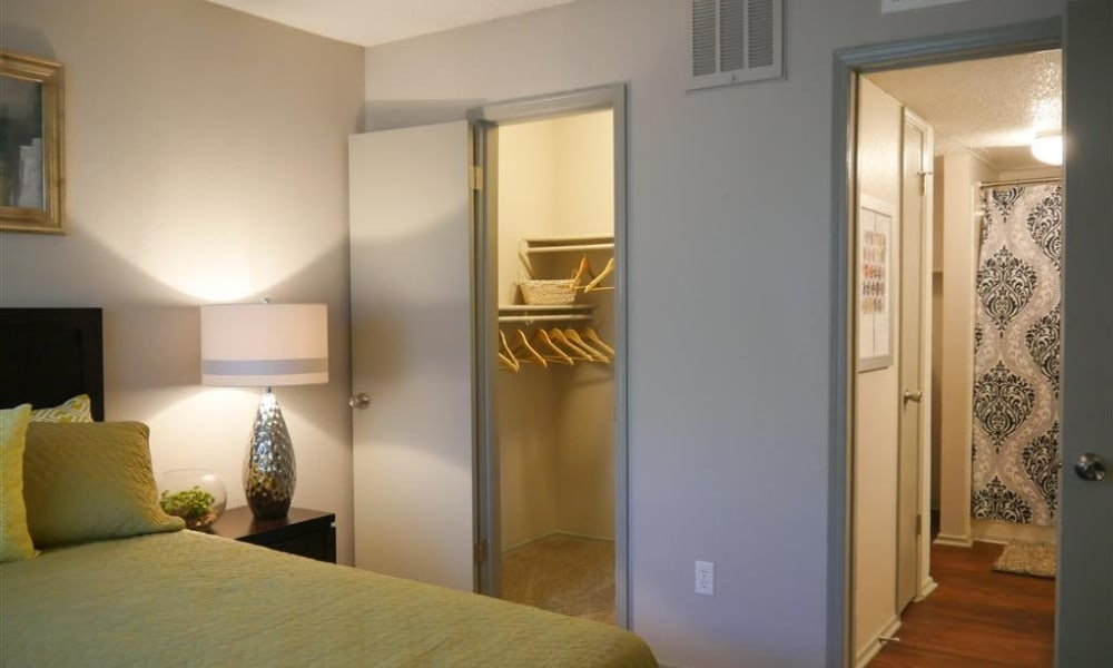 Bedroom with closet and bathroom at Trails of Towne Lake in Irving, Texas