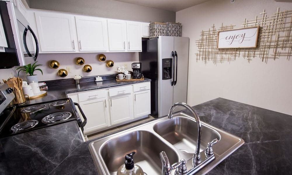Large stainless steel sink at Watercress Apartments in Maize, Kansas
