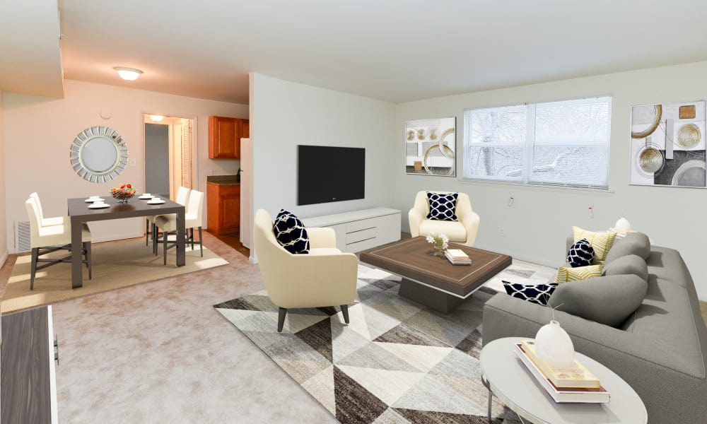 A living room that is great for entertaining at Woodcrest Apartment Homes in Dover, Delaware