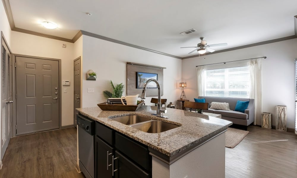 Kitchen island and living room at Plum Creek Vue in Kyle, Texas