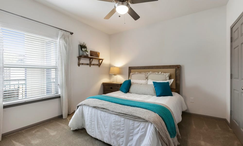Naturally lit model bedroom at Plum Creek Vue in Kyle, Texas