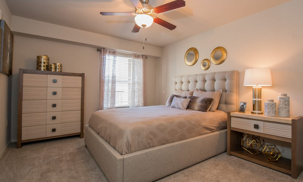 Luxury bedroom at Cottages at Tallgrass Point Apartments in Owasso, Oklahoma