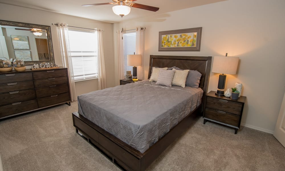 Spacious bedroom at Cottages at Tallgrass Point Apartments in Owasso, Oklahoma