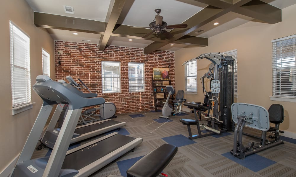 Well equipped fitness center at Cottages at Tallgrass Point Apartments in Owasso, Oklahoma