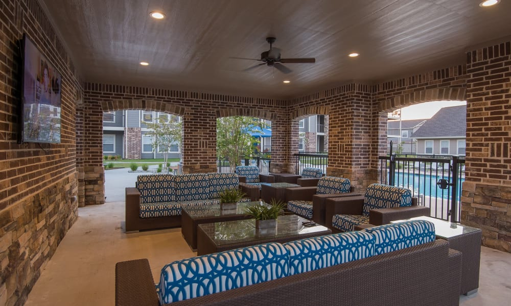 Exterior seating area by the pool at Cottages at Tallgrass Point Apartments in Owasso, Oklahoma