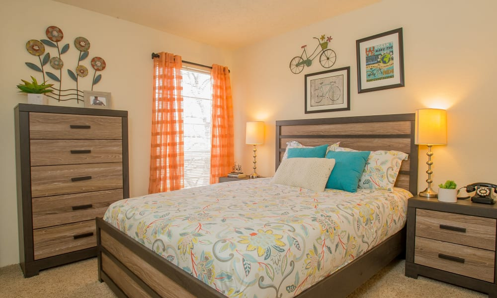 A large bed in an apartment at Country Hollow in Tulsa, OK