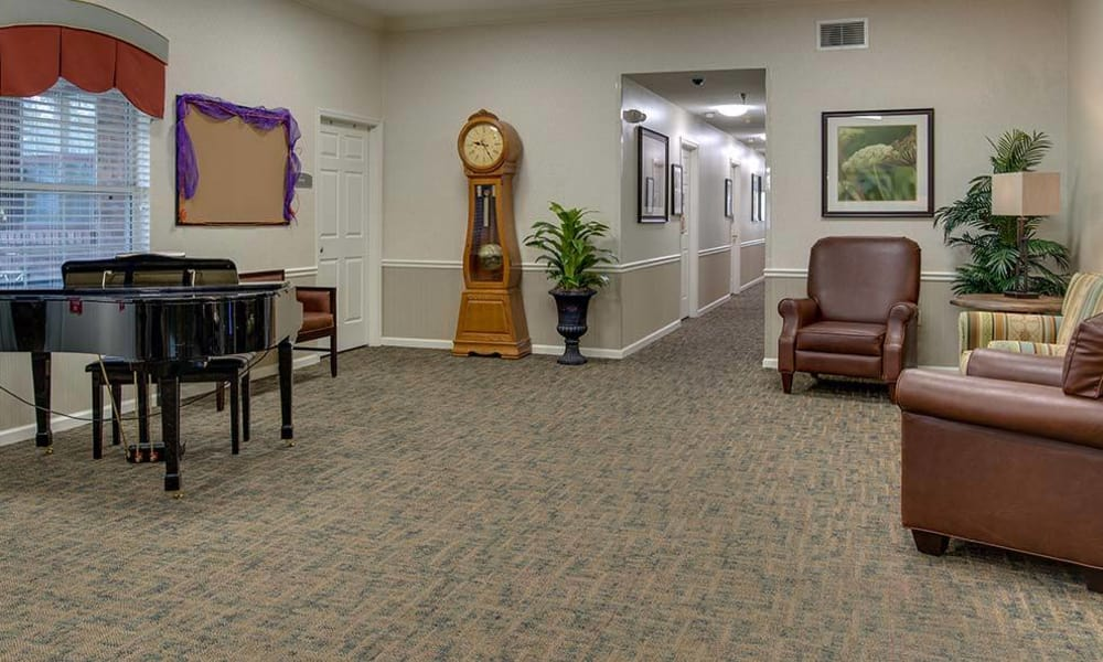 Relaxation room with a piano at The Arbors at Glendale Gardens in Clinton, Missouri