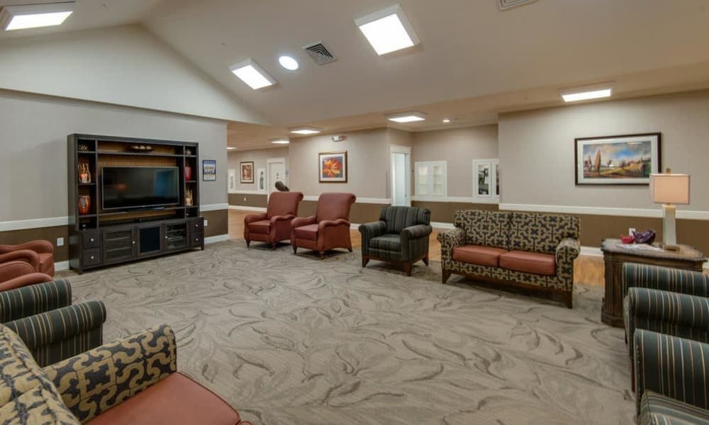 Tv room with ample seating at The Arbors at Parkside in Rolla, Missouri
