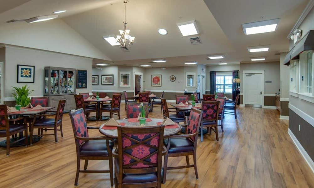 Open dining hall with hardwood floors at The Arbors at Parkside in Rolla, Missouri