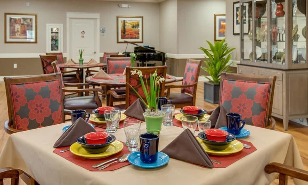 Dining table with colorful tableware at The Arbors at Parkside in Rolla, Missouri